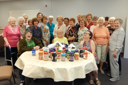 Members of the Miriam Circle celebrate the collection of 68 pairs of socks and 57 items for the Food Pantry and Health Kits at their September Meeting.